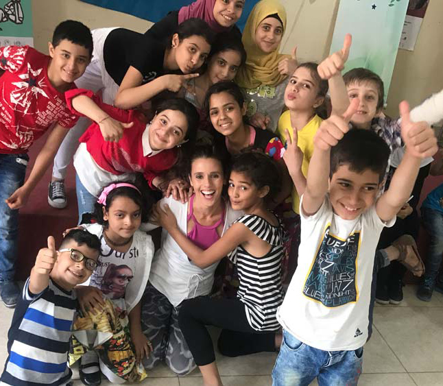 photo of syrian children in lebanese refugee camp being funded for dance education