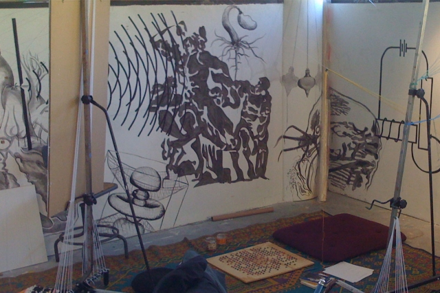 A painting studio with exciting wall designs.