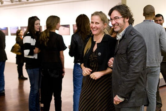 People smiling in an art gallery