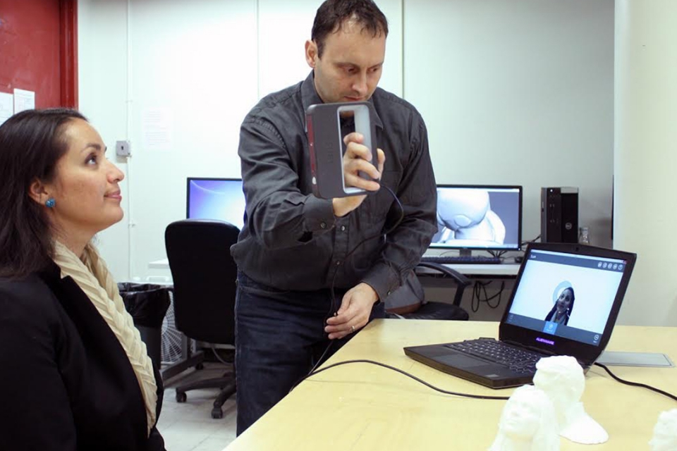 Davide Prete takes a 3D scan of a student