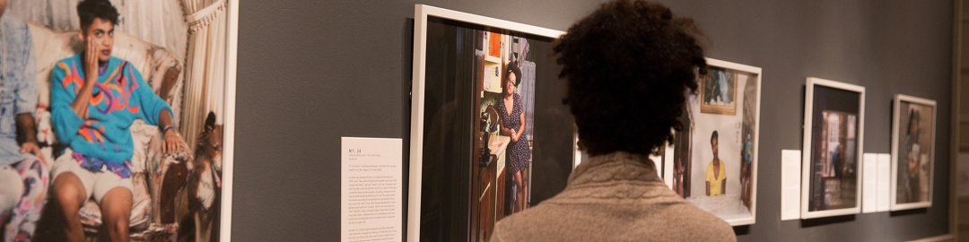 Woman looking at photographs in a gallery