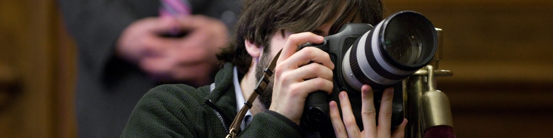Student taking a photo at an event