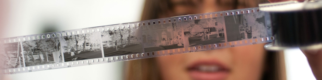 Student looking at black and white negatives