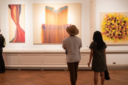 Students looking at art in the Brady Gallery