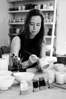 photo of kate hardy working on a ceramics piece