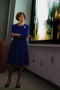 photo of lilien robinson teaching in front of a projector screen