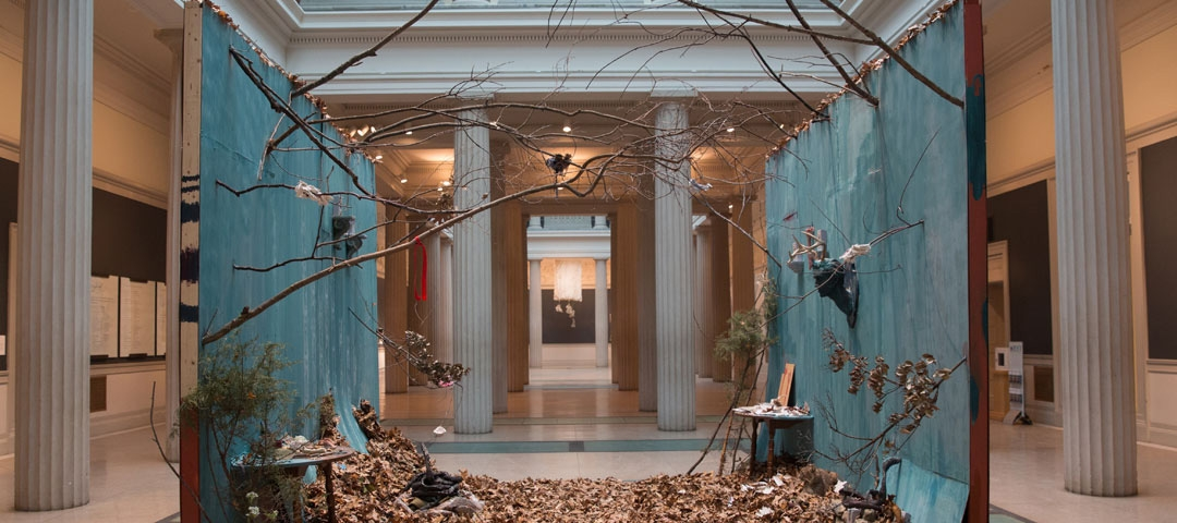 "Whitney Waller's exhibit ""Dasein"" for Corcoran NEXT in 2015, a collection of walls, branches, and leaves."