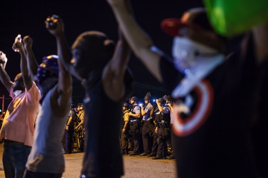 Protestors hold hands at a Michael Brown demonstration