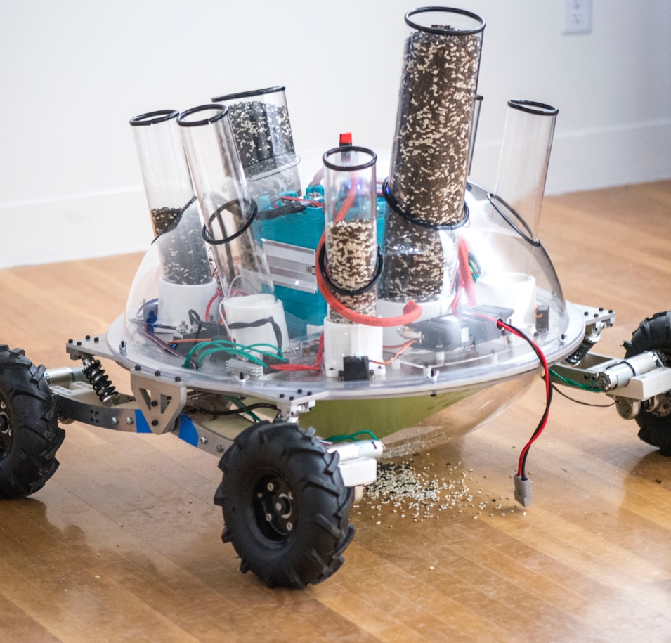 Robot with wheels and tubes full of seed