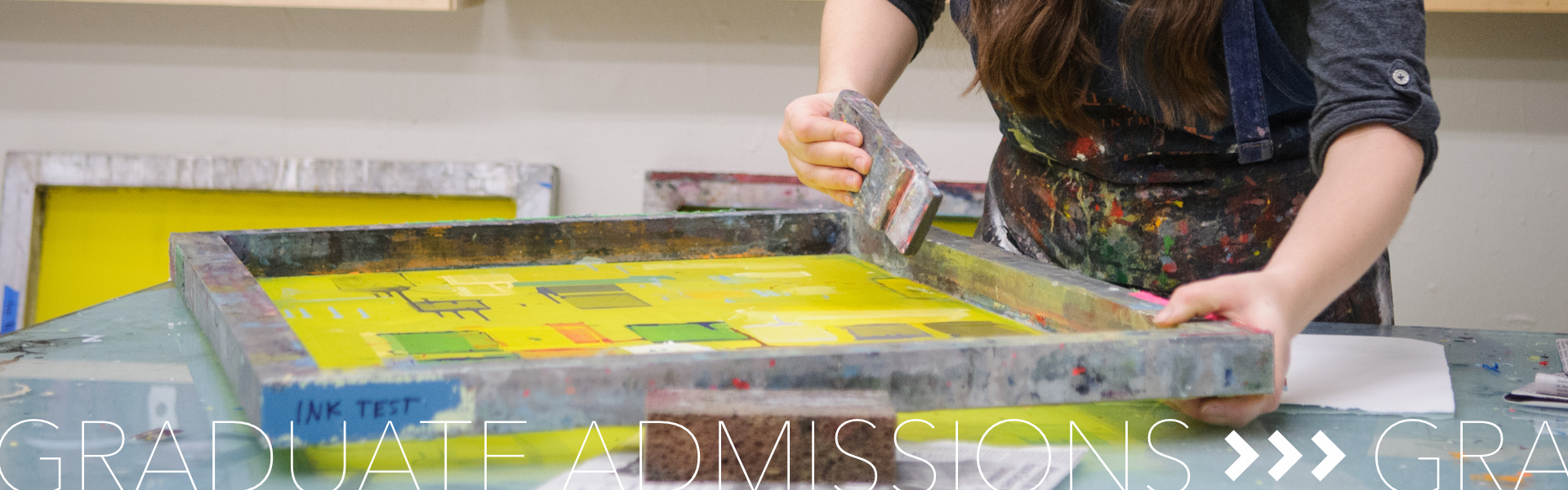 Graduate Admissions; student painting in frame