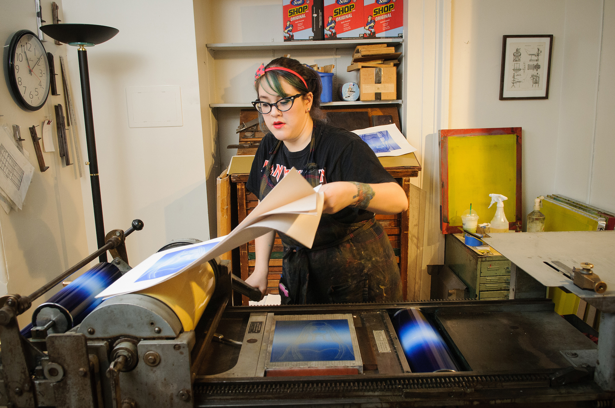Student working on a printing press