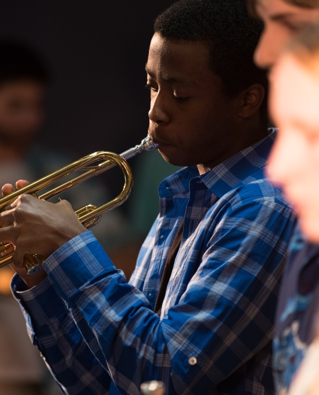 Young student playing trumpet