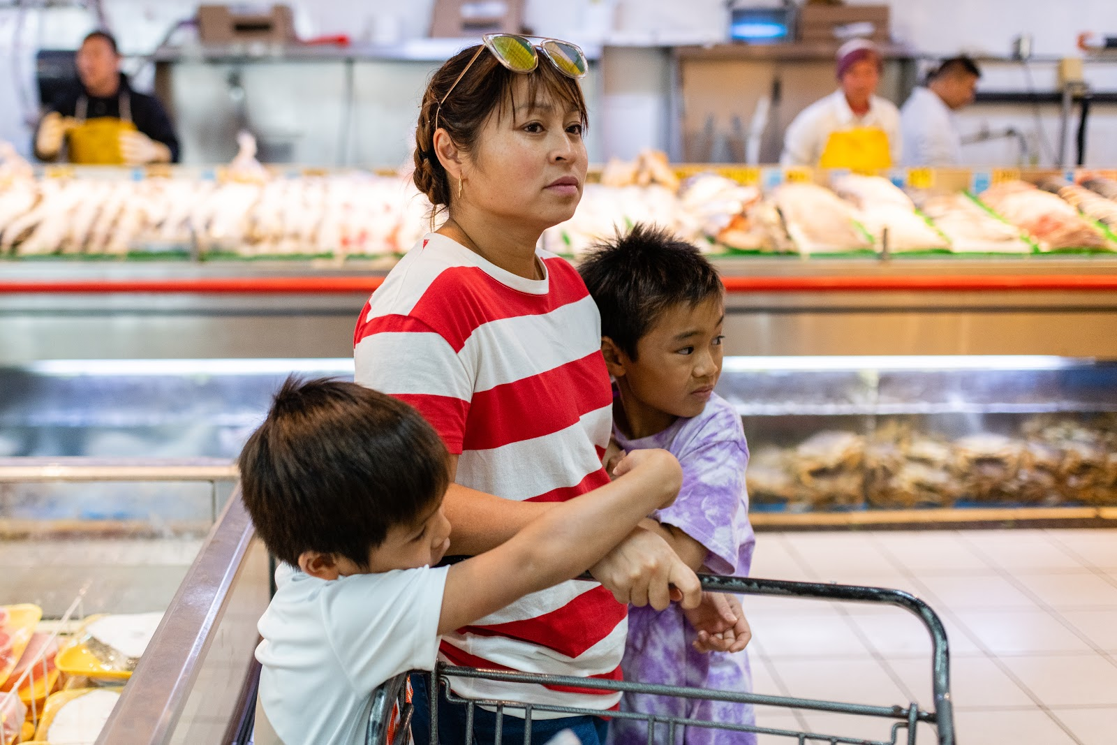 Mother and children in grocery store