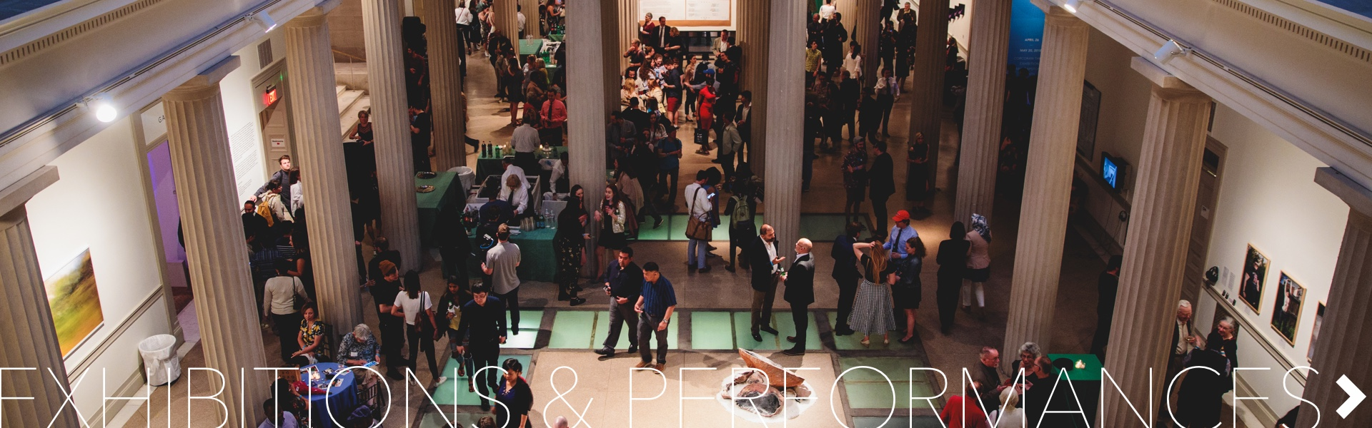 Exhibitions & Performances; large group of people in the Flagg building atrium for an event