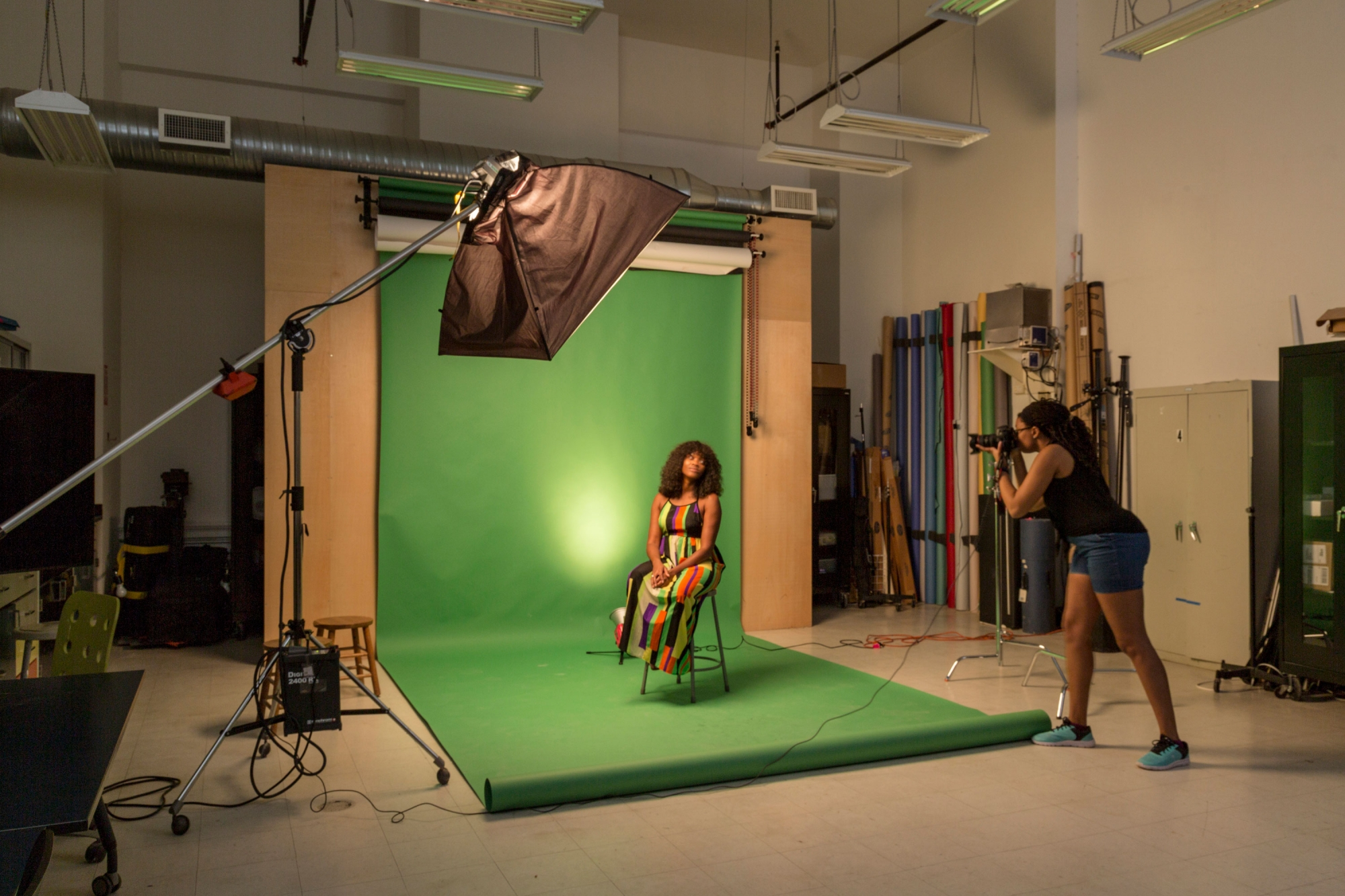 Students taking a photo in the lighting studio