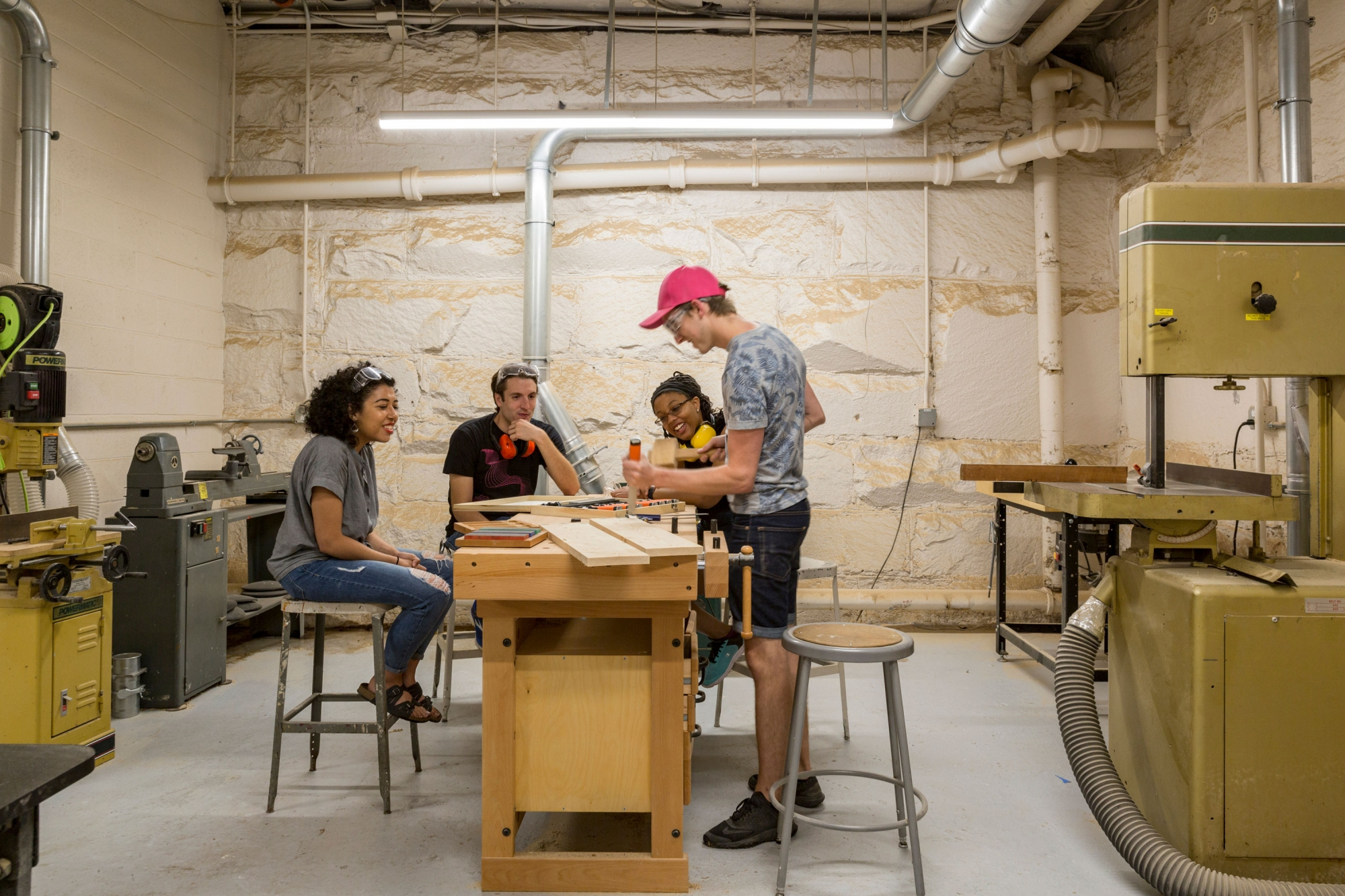 Students working with woodworking tools