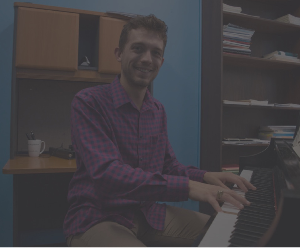 Choir Director Blake Clark playing piano
