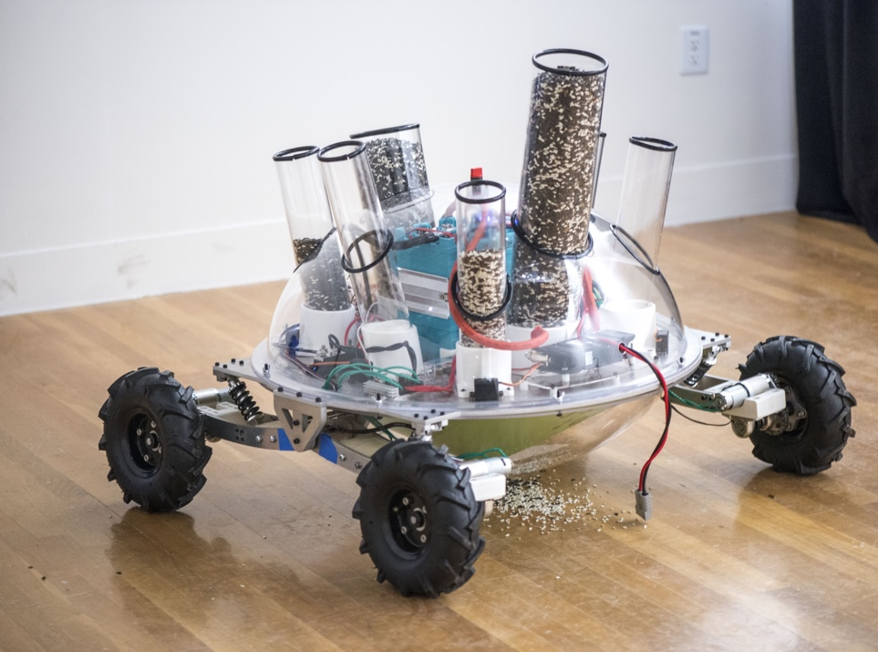 Bloombot: robot with wheels and tubes of seeds