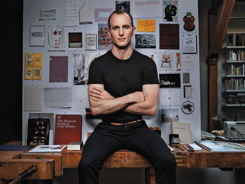 Joe Gebbia sitting on desk