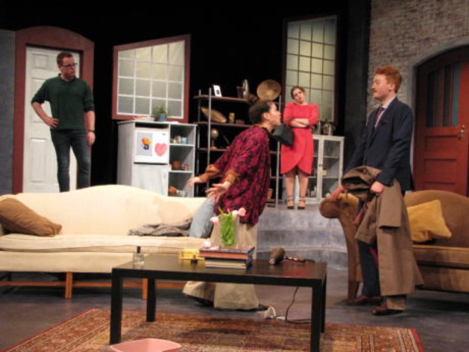 Students performing in living room scene on stage