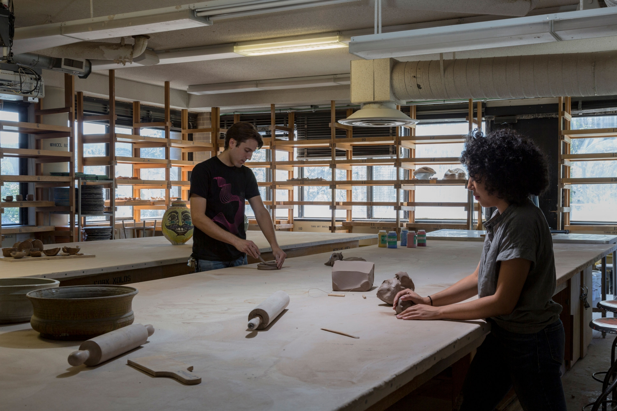 Two students working on projects in the ceramics lab