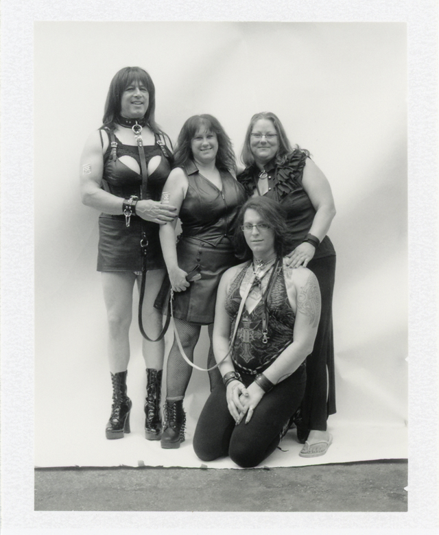 Photo of a family in fetish costumes