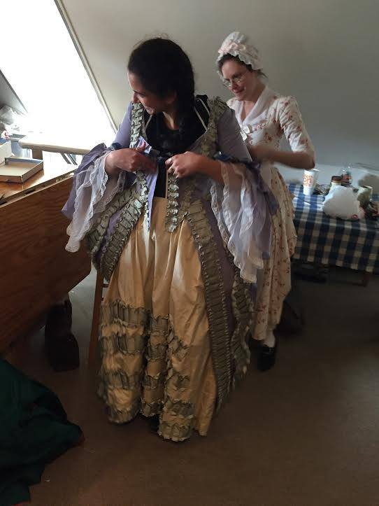 Student getting dressed in an 18th century gown