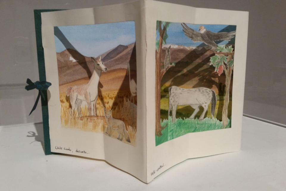 Delicate cut-out paper animals in the pages of an open book