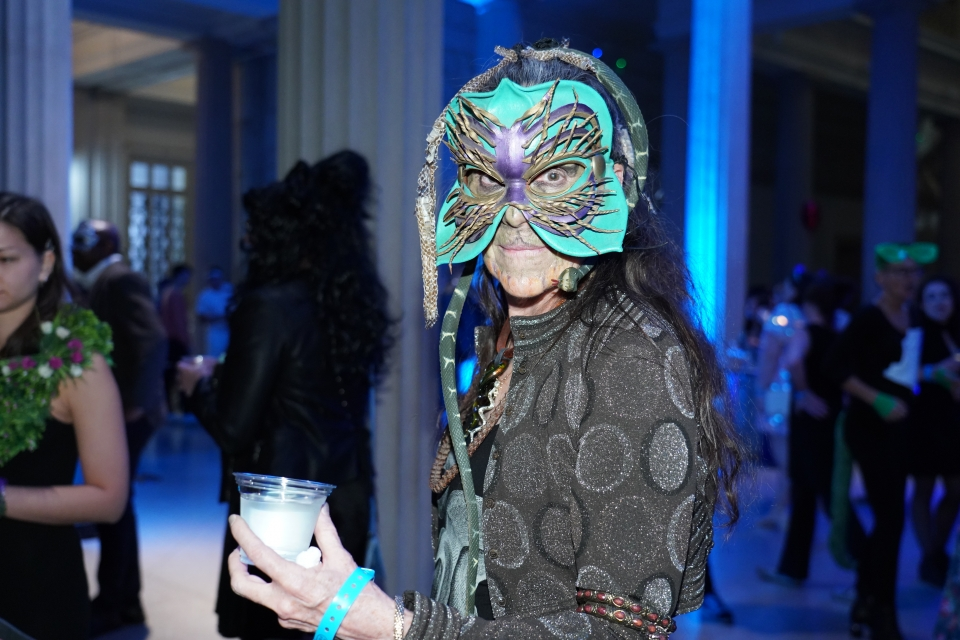Attendee dressed as a masked serpent creature