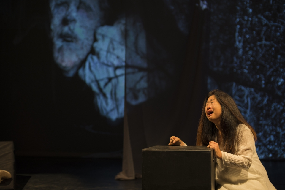 "Hong crying while performing in ""On the Threshold of Winter."""