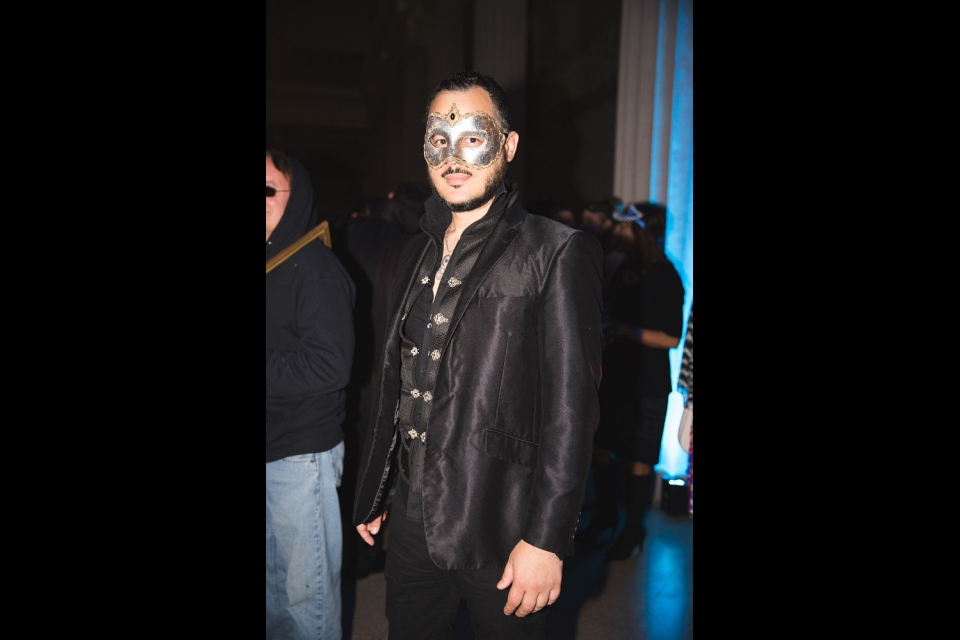 Man in Leather and Masquerade Mask