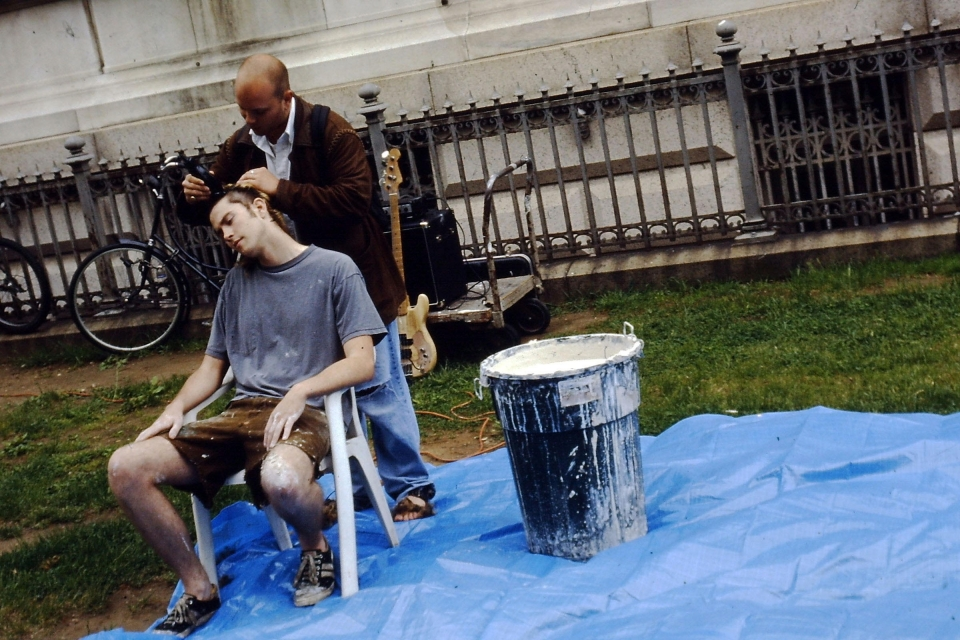Sheridan getting his head shaved as part of a performance piece at the Corcoran