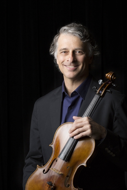 Uri Wassertzug poses with violin