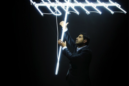 Ahmed Mater holds aloft a neon antenna