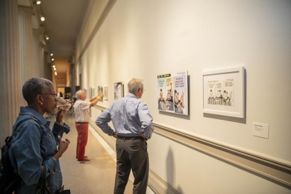 """Guests view Rogers' work at opening night of """"Spiked"""" exhibit."""