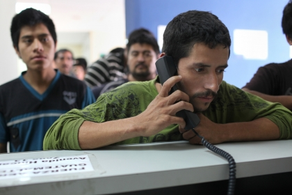 A man makes a phone call after being deported