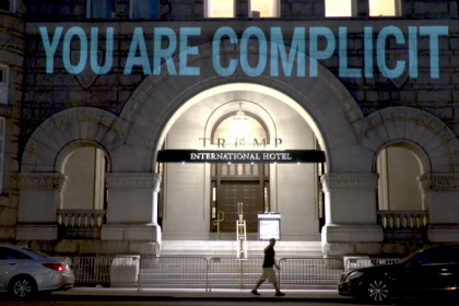 "A projection from Robin Bell's ""Emoluments Welcome."" (bellvisuals.com)"