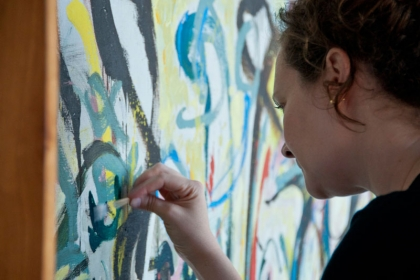 Laura Rivers in front of a Pollock painting